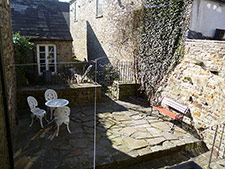 Patio to the Rear of Half Moon House Holiday Cottage
